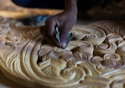 Hand polishing wooden carved bed in lamu, Kenya