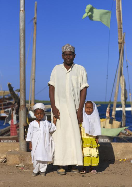 A muslim father and his two young children, Lamu County, Lamu, Kenya