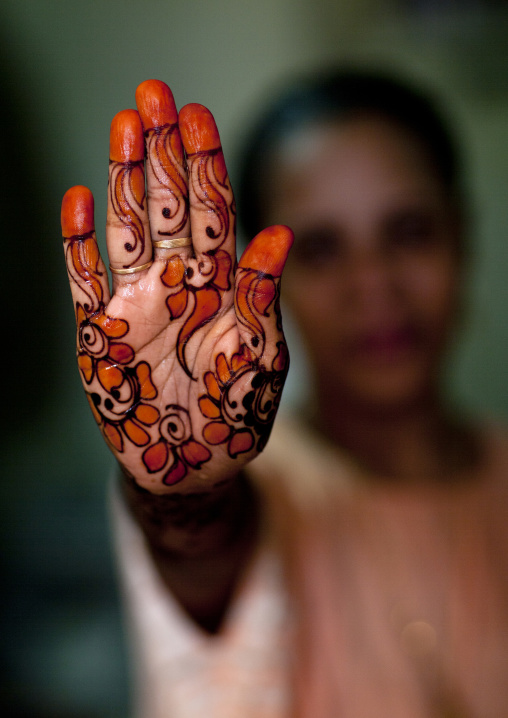 Unrecognizable person shows hand palm painted with henna, Lamu County, Lamu, Kenya