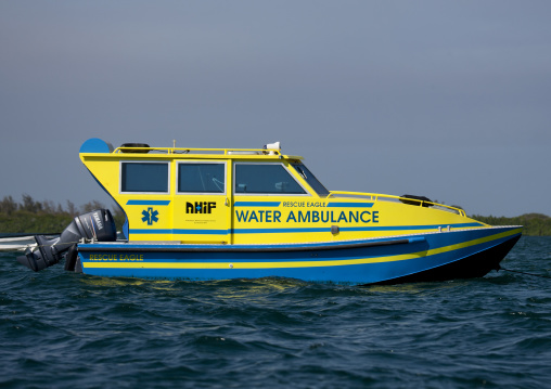 Ambulance boat ready for emergency in channel, Lamu, Kenya