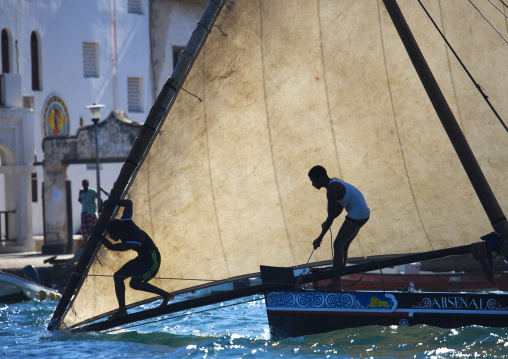 Arsenal dhow passing the lamu jetty during the race ,  Maulidi  festival , Lamu kenya