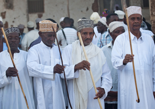 Men dancing goma stick dance at maulidi festival, Lamu, Kenya