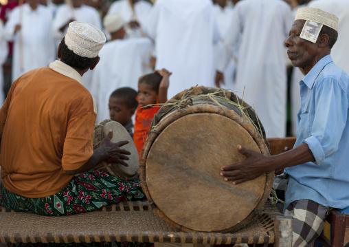 Muslim men celebrating the Maulid festival, Lamu County, Lamu, Kenya