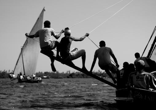 Man balancing dhow while sailing, Dhow race, Maulidi, Lamu kenya