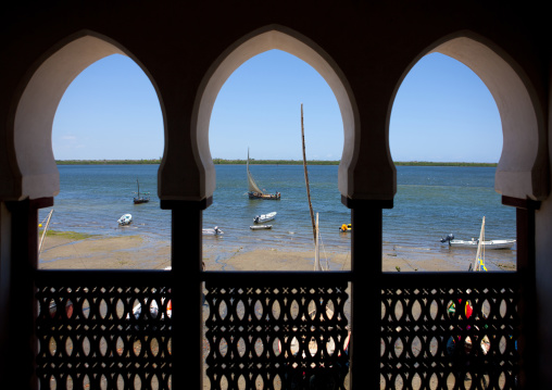 View on the sea and coast through arabic style window frame, Lamu, Kenya