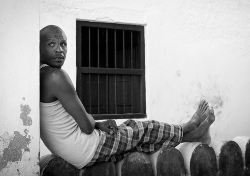 Man sitting on a wall in lamu, Kenya