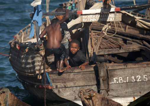 Two young boys playing at the poop deck of a dhow, Lamu County, Lamu, Kenya