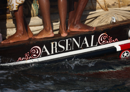 Arsenal dhow boat with human wet feet lamu, Kenya