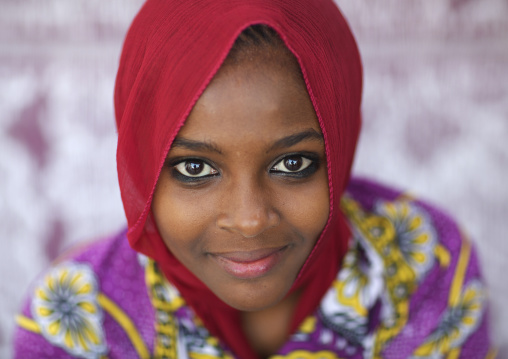 Portrait of beautiful light brown skin teenage girl looking at camera, In lamu, Kenya