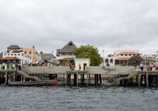 People lazing around the dockside in lamu, Kenya