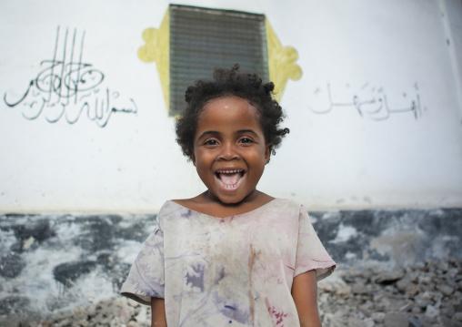 Girl laughing at photographer, Lamu, Kenya