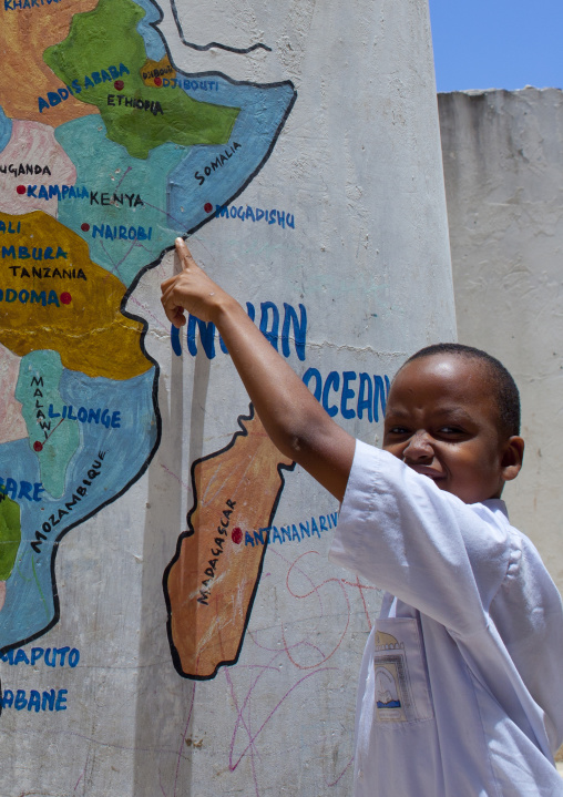 Young boy showing lamu on a painted map, Lamu school, Kenya