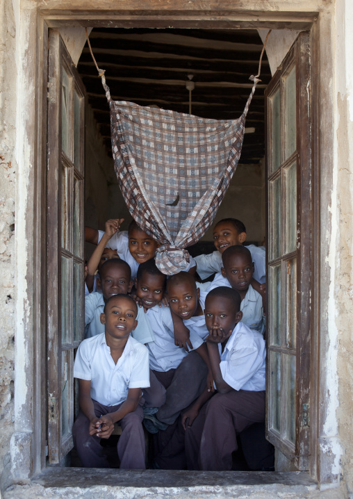 Group of schoolboys in the frame of the classroom stonetown academy lamu, Kenya