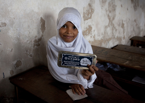 Young girl wearing white hijab veil in the classroom of stonetown academy lamu, Kenya