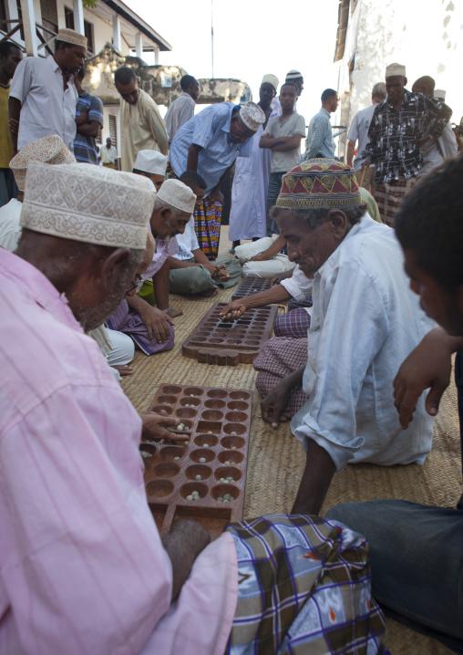 Players of bao in the street, Lamu County, Lamu, Kenya