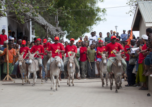 Boys preparing to compete during the donkey race, Lamu, Kenya