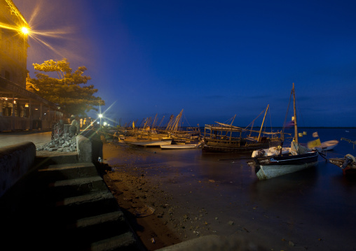 Dhows standing by the dockside of lamu kenya by night