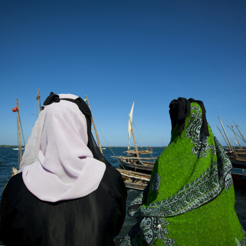 Two women looking at the sea, Lamu, Kenya