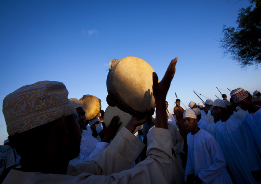 Man playing drums during Maulid festival, Lamu County, Lamu, Kenya