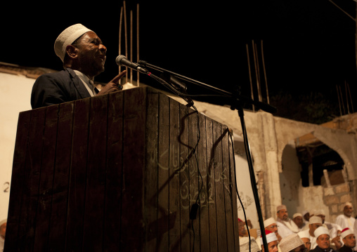 A man speaking in a microphone during maulidi festival, Lamu, Kenya
