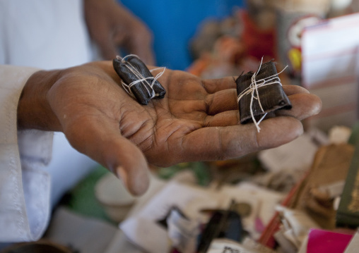 Little magic artefacts in the hand of witch doctor, Lamu, Kenya