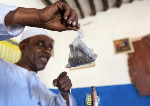 Kenyan witch doctor practicing black magic in his house, Lamu County, Lamu, Kenya