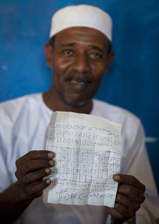 Witch doctor practicing black magic in his house, Predicting the winner of the race, Maulidi festival, Lamu kenya