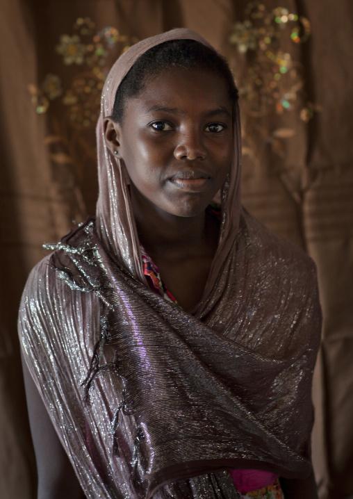 Teenage cute girl in nice posture with veil smiling at camera, Lamu, Kenya
