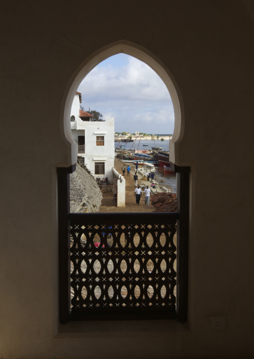 View of lamu seashore through arabic style window, Lamu kenya