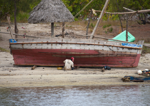 A shipbuilder on the beach, Lamu County, Lamu, Kenya