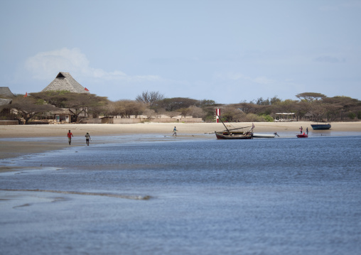 People walking by the gulf of manda island  beach, Lamu kenya