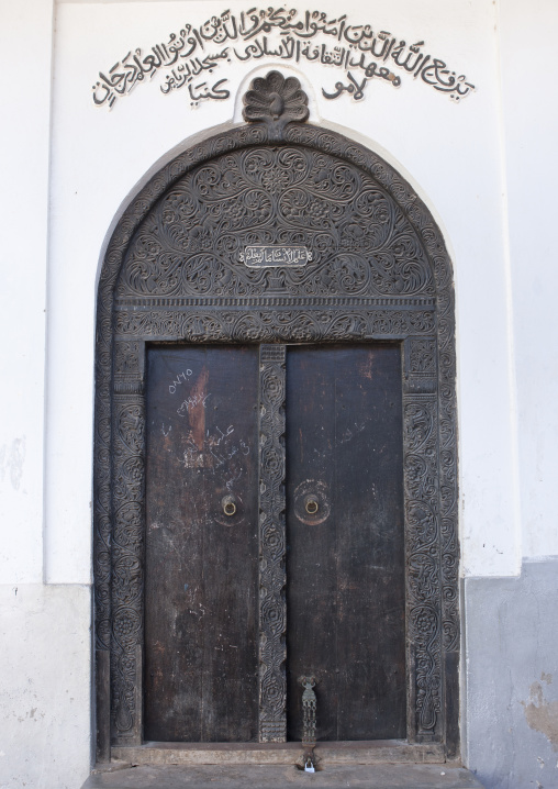 An omani style entrance wooden carved door with inscriptions, Lamu, Kenya