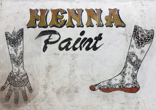 Henna paint sign painted on a wall, Lamu, Kenya