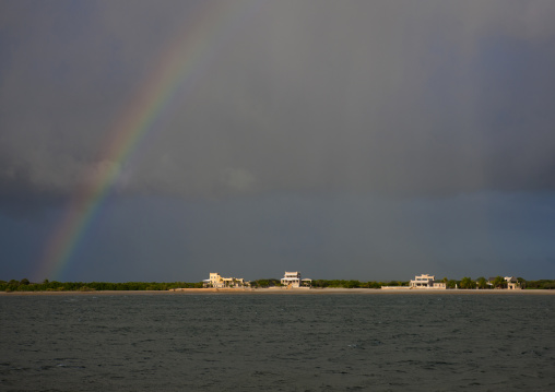 A rainbow in the middle of rainy clouds over manda island, Lamu kenya