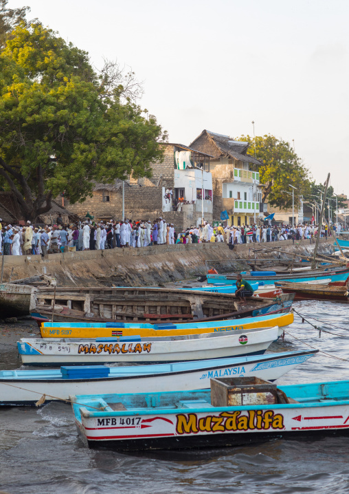 Sunni muslim people parading during the maulidi festivities along the harbour, Lamu county, Lamu town, Kenya