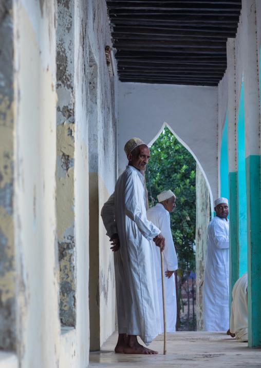 Old muslim men standing at the entrance of a mosque, Lamu county, Lamu town, Kenya