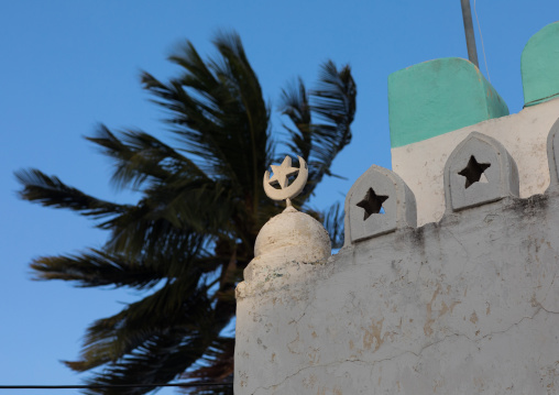 Star and moon on the roof of a mosque, Lamu county, Lamu town, Kenya