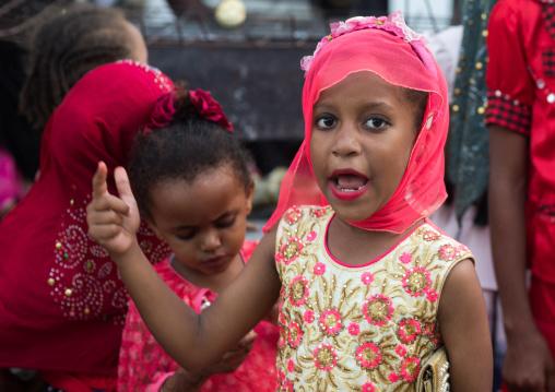 Young girls dressed in colorful way, Lamu county, Lamu town, Kenya