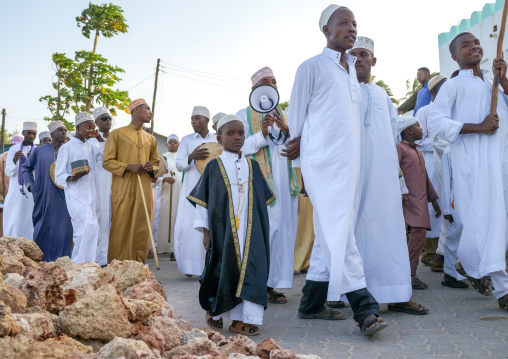 Sunni muslim people parading during the maulidi festivities in the street, Lamu county, Lamu town, Kenya