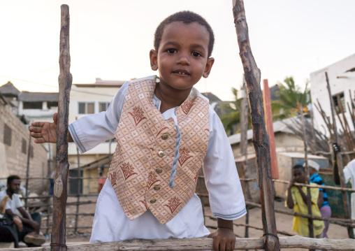 Sunni muslim boy dressed for the maulidi festivities, Lamu county, Lamu town, Kenya