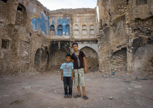 Kurdish Children In Front Of An Abandoned House, Koya, Kurdistan, Iraq