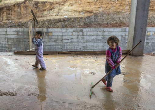 Yezidi Refugees Displaced From Sinjar Living In An Under Construction Building And Cleaning After A Storm, Duhok, Kurdistan, Iraq