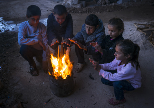 Yazidi Refugees Children Displaced From Sinjar Making Fire In An Under Construction Building, Duhok, Kurdistan, Iraq