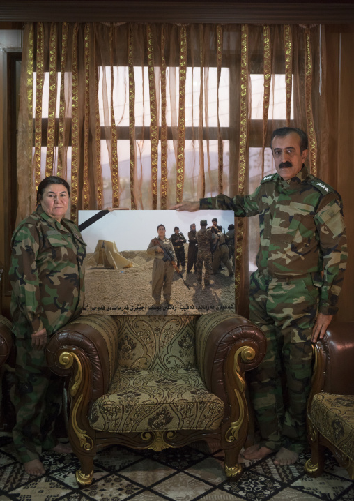 Nasrin Hamalaw AndYousuf Majid With A Picture Of Their Dead Daughter, Captain Rangin Yousuf, Sulaymaniyah, Kurdistan, Iraq