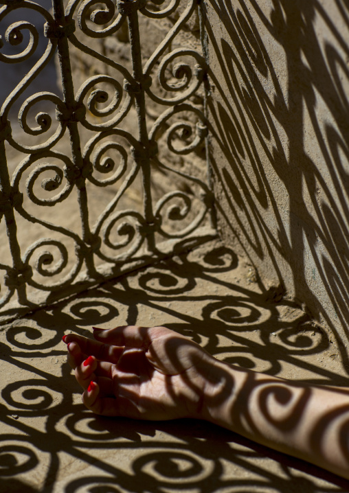 Woman Hand In The Shadow Of A Wrought Iron Window In The Citadel, Erbil, Kurdistan, Iraq