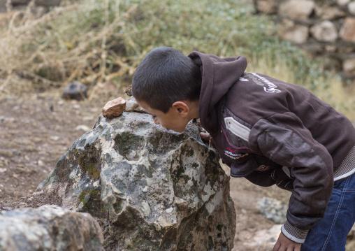 Yezedi Refugee From Sinjar Kissing A Sacred Stone In Lalesh Temple, Kurdistan, Iraq