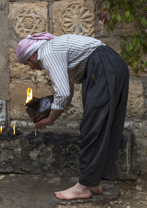 Yezedi Fakirs Lighting Sacred Fire In The Streets,  In Lalesh Temple, Kurdistan, Iraq