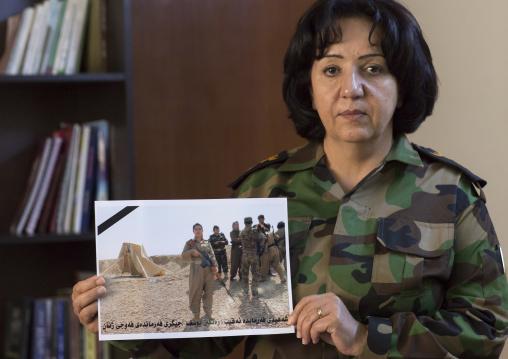 Colonel Nahida Ahmad Rashid With A Picture Of Captain Rangin Yousuf Killed By Daesh, Sulaymaniyah, Kurdistan, Iraq