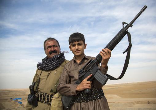 Kurdish General And His Son On The Frontline, Kirkuk, Kurdistan, Iraq
