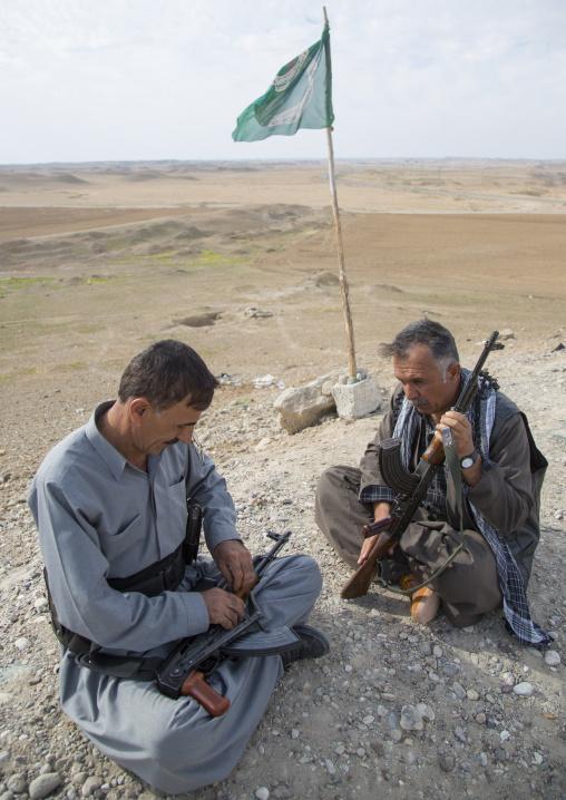 Kurdish Peshmergas Cleaning Their Kalashnikovs On The Frontline, Kirkuk, Kurdistan, Iraq
